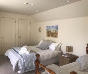 Upstairs bedroom with a queen size bed and a single